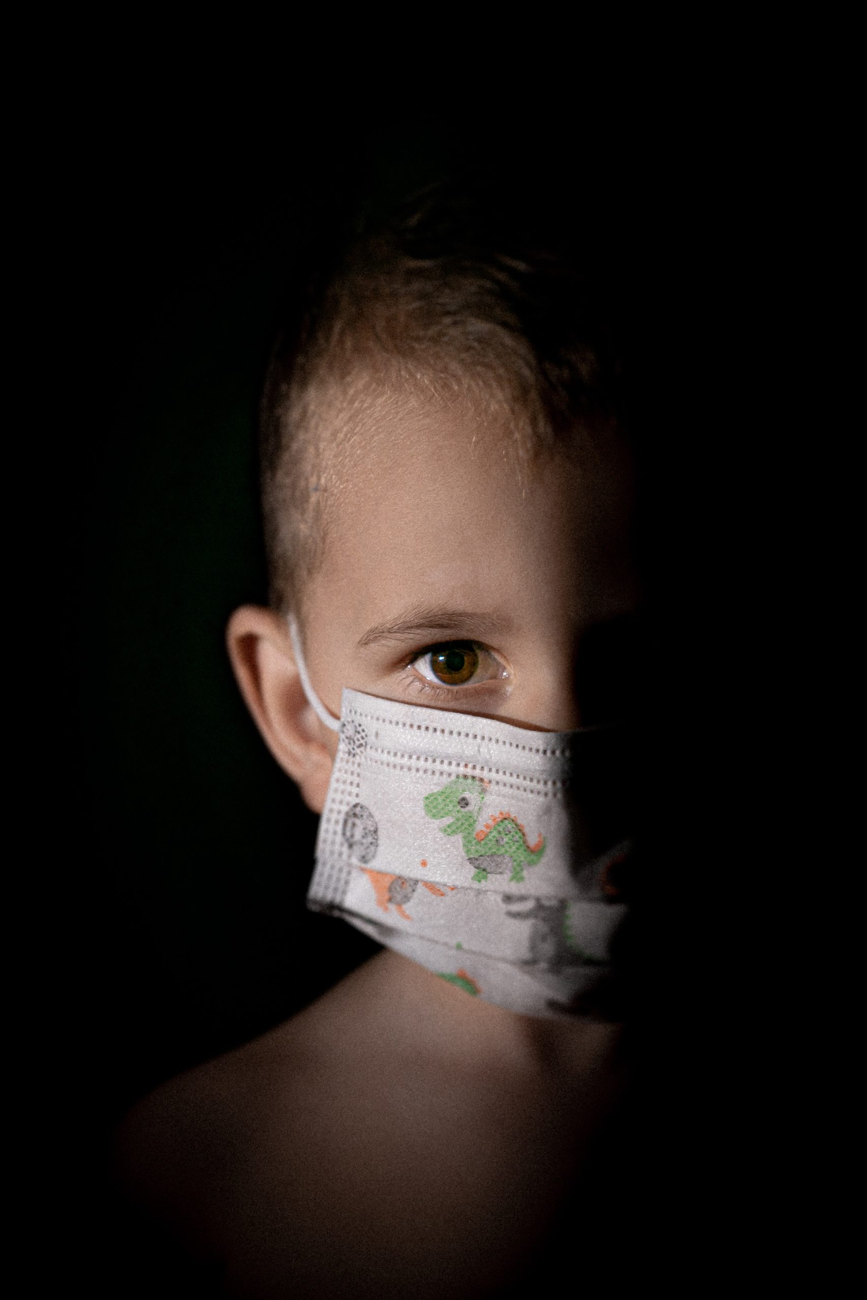 child wearing a covid-19 mask for protection